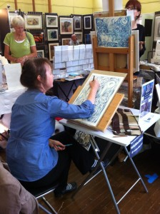 D Y Hide (Debbi) in action working on one of her beautiful coloured pencil designs.