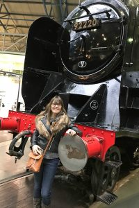 Me standing next to The Evening Star (one of the steam engines my Grandpa used to drive) at the National Railway Museum, York.